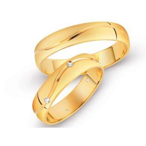 Обручальные кольца с волной и фианитами